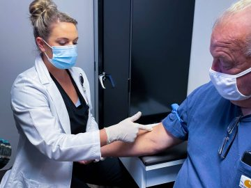medical professional at mountain lakes physicians group checking patient